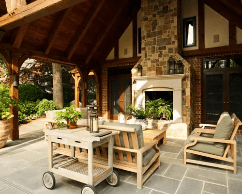 Traditional front porch fireplace and old furniture design
