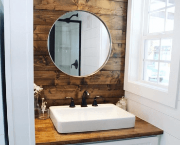 Tiny house bathroom with mirror